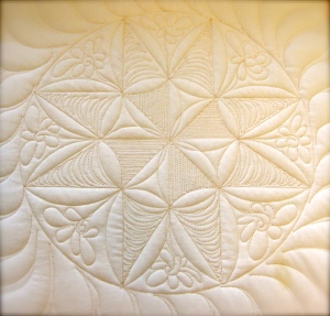 This is a close up of one of the white blocks.  I quilted it like a sampler with some variation in every block.