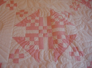 One of the pieced blocks.  Whoever pieced this, did it all by hand.  Each small square is less than an inch square.