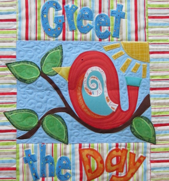 Greet the Day quilt close up.